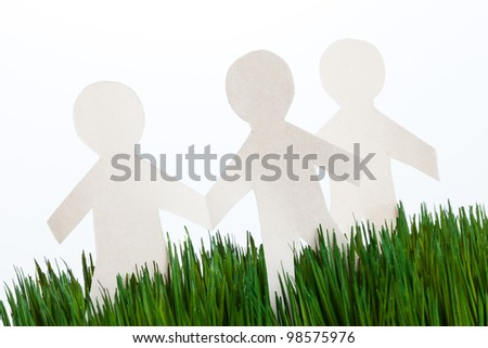 green grass and Paper Chain men, concept of Environmental Conservation #98575976