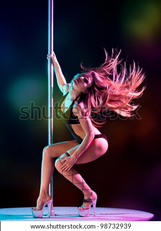 attractive sexy woman pole dancer performing on stage