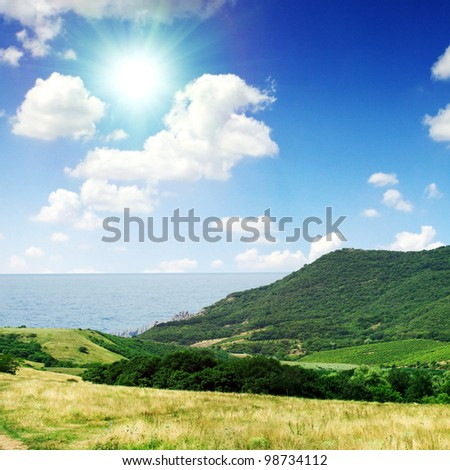 Summer day landscape with the sea and mountains. #98734112