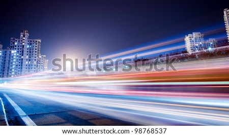 the light trails on the modern building background in shanghai china. #98768537