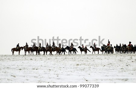 TVAROZNA, CZECH REPUBLIC - DECEMBER 3: History fans in military costumes reenact the battle of Austerlitz, which Napoleon won in 1805, on December 3, 2005 near the village of Tvarozna, Czech Repuplic. #99077339