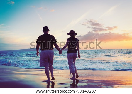 Senior Couple Enjoying Sunset at the Beach #99149237