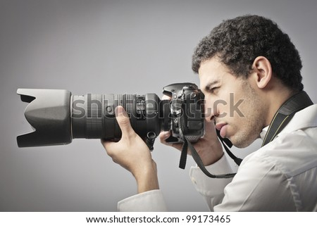 Young photographer taking pictures with a reflex camera #99173465