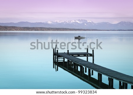 An image of a wooden jetty at the lake Starnberg in Bavaria Germany #99323834