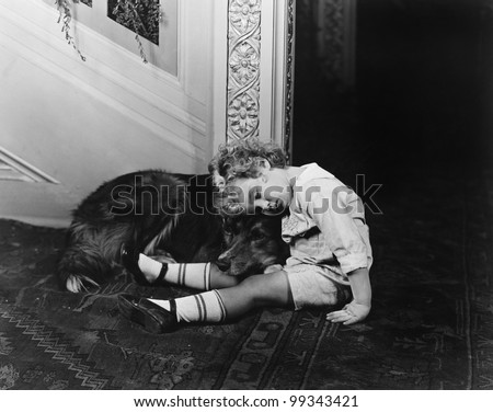 Sleeping child with dog #99343421