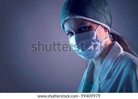 Close-up portrait of a young female nurse #99409979
