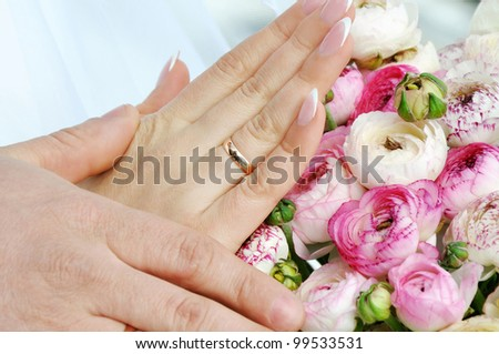 Hands and rings on wedding bouquet #99533531