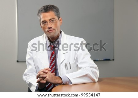 successful male doctor in his office #99554147