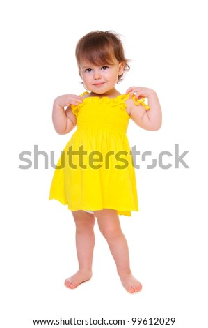 Pretty girl posing for the camera, in a yellow short dress. isolated on white
