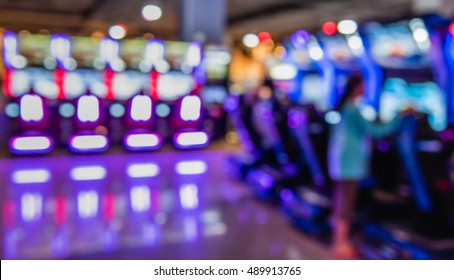 Image of abstract blur Arcade game machine shop with bokeh for background usage . (vintage tone)