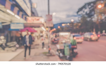 Image of Abstract Blur Street night market with bokeh for background usage .(vintage tone)