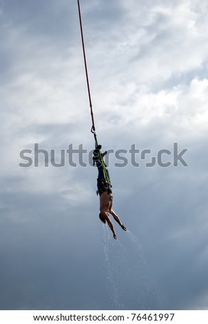an image of an action sports thrill seeker after jumping from a bungee platform.