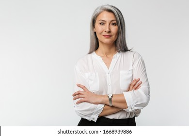Image of adult mature woman with long gray hair wearing office clothes isolated over white background