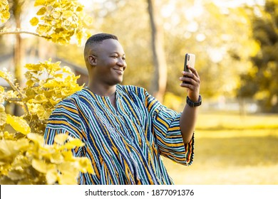 image of african guy with smart phone- outdoor concept