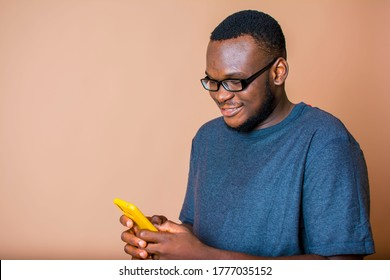 Image of an African man using his mobile phone