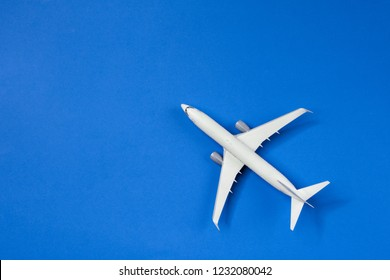 Image of airplane isolated on empty blue background