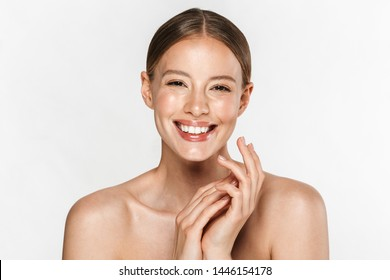 Image of alluring half-naked woman smiling at camera and holding hands together isolated over white background