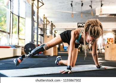 Image of amazing strong disabled sports woman make sport exercises in gym.