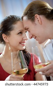 Image of amorous couple toasting and looking at each other