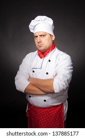 An image of an angry chef in white clothing