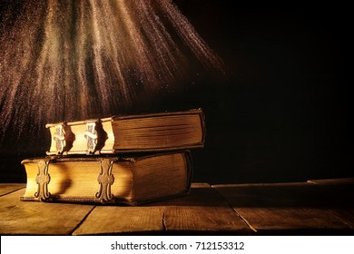 Image of antique books, with brass clasps on old wooden table. fantasy medieval period and religious concept