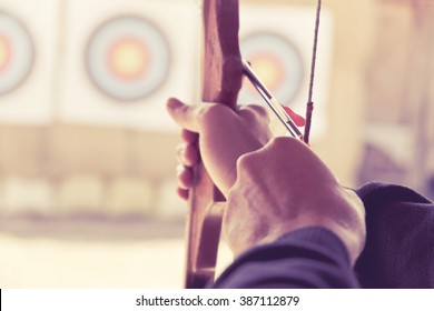 image of Archer holds his bow aiming at a target
