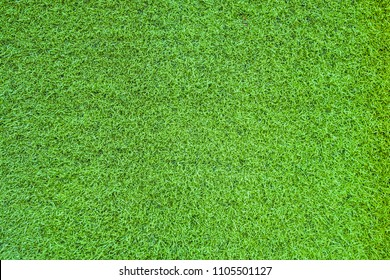 image of Artificial grass texture taken from the top view .