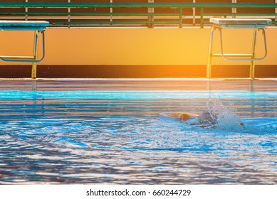 image of asian boy at swimming pool.