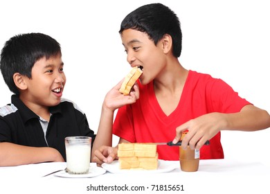 image of asian boys sharing a food