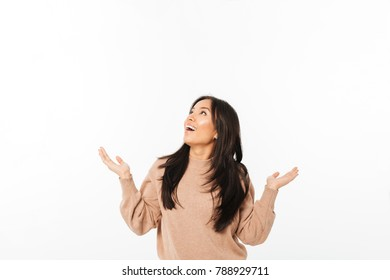 Image of asian excited surprised lady standing isolated over white background looking aside.