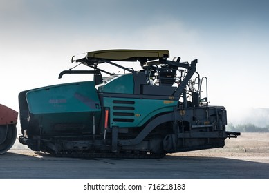 Image of asphalt spreader machine with blue color