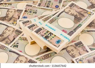 "Image of asset, property. Translation: ""Bank of Japan Tickets"" ""One hundred thousand yen"" ""The Bank of Japan"""