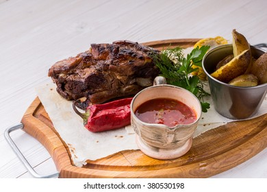 an image of Assorted delicious grilled meat with vegetable over wooden plate