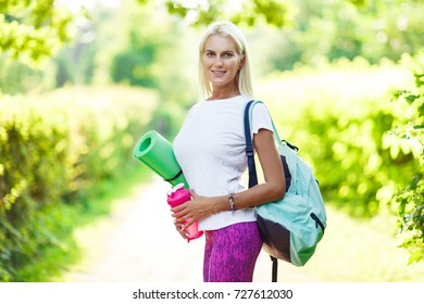 Image of athletic girl with sports rug