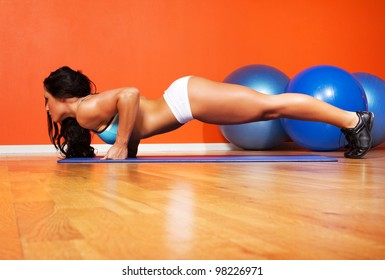 Image of athletic woman doing exercise