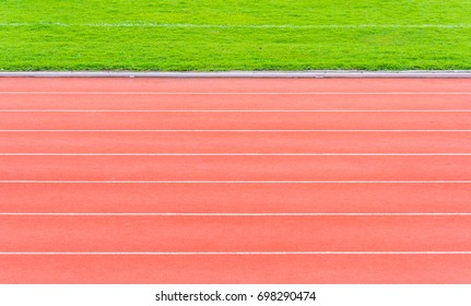 image of athletics track lane made with orange rubber for background texture.