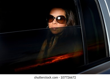 Image of attractive female in vehicle window