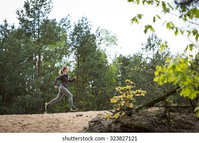 Image of attractive fitness girl exercising in nature