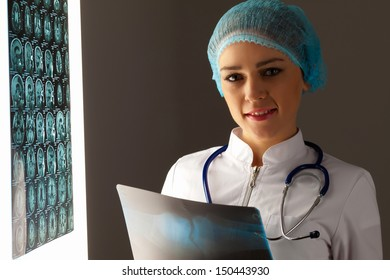 Image of attractive woman doctor holding x-ray results