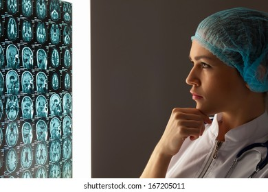 Image of attractive woman doctor looking at x-ray results