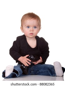 Image of a baby holding a video game controller.