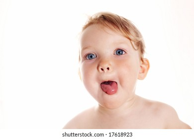 An image of a baby-girl showing her tongue