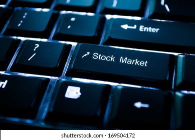 image of a backlit keyboard with stock market written on a key