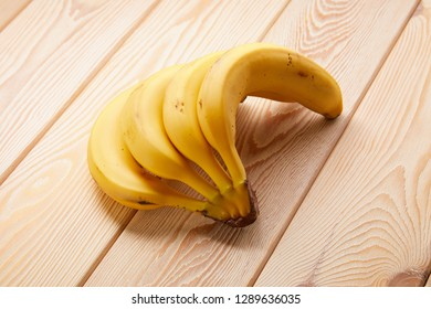 Image of Banana cluster on wooden table