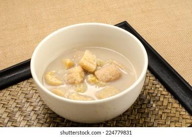 Image of banana in coconut milk, Thai dessert in ceramic bowl