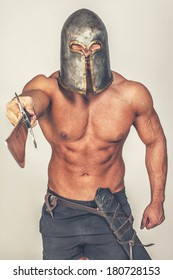 Image of barbarian who is pointing with his sword on someone