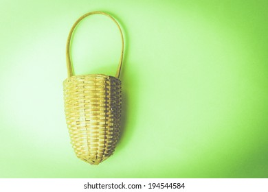 image of a basket on a green vintage background