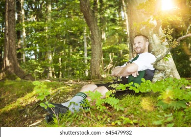 An image of a bavarian traditional man in the forest