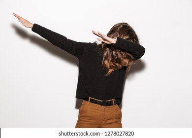 Image of a beautiful amazing woman posing isolated throws dab.