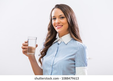 Image of beautiful businesswoman holding glass of water.